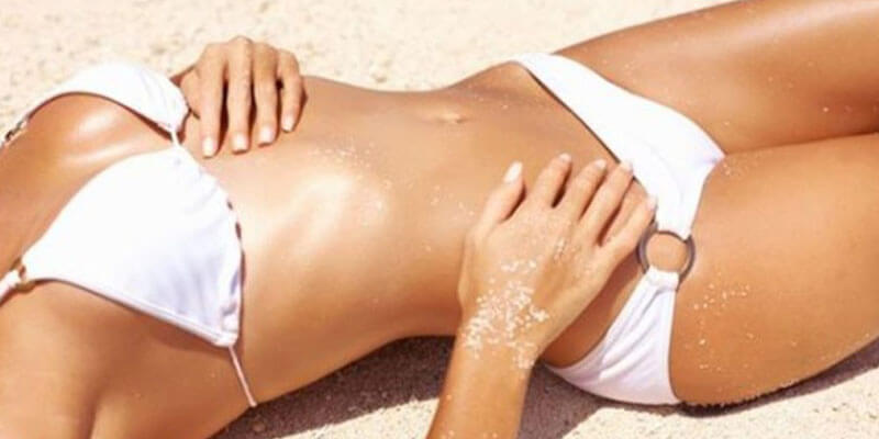 woman on the beach brazilian sugaring wax